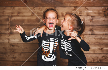 holiday halloween. funny funny sisters twins children in carniva 33941180
