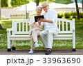 happy senior couple with tablet pc in city park 33963690