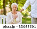 senior woman feeling sick at summer park 33963691