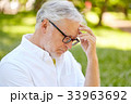thoughtful senior man at summer park 33963692