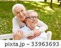 happy senior couple hugging in city park 33963693