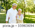 happy senior couple hugging in city park 33963694