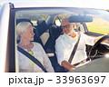 happy senior couple driving in car 33963697