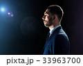 businessman over black background with lens flare 33963700