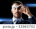 businessman with transparent smartphone 33963702