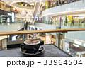 Enjoying coffee in a shopping mall 33964504