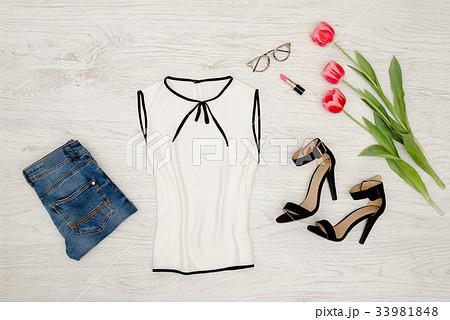 Fashion concept. Part of a white blouse, glassesの写真素材 [33981848] - PIXTA