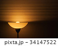 Lampshade on wallpaper 34147522