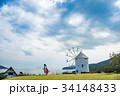 小豆島 道の駅 初夏のオリーブ公園 ギリシャ風車の前で魔法のほうきに乗る女性 34148433