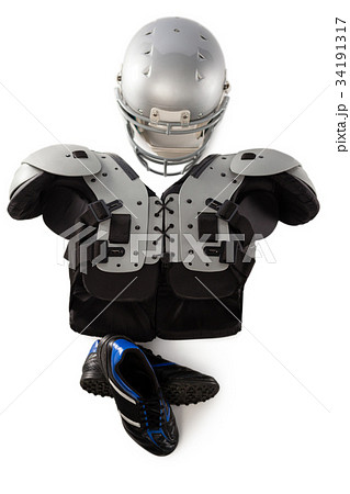 Close up of America football and helmet by sports shoesの写真素材 [34191317] - PIXTA