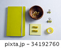 Digital tablet, laptop, wire and pencil holder on wooden table in office 34192760