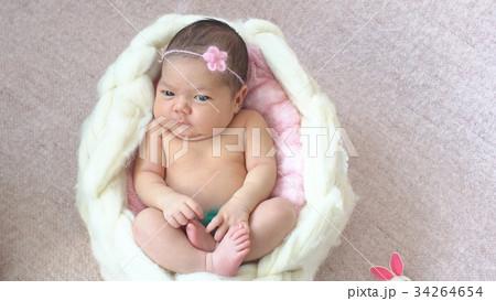 Little newborn baby girl in the Studio. 34264654
