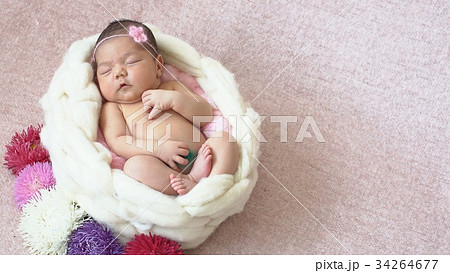 Little newborn baby girl in the Studio 34264677
