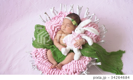 Little newborn baby girl in the Studio 34264684
