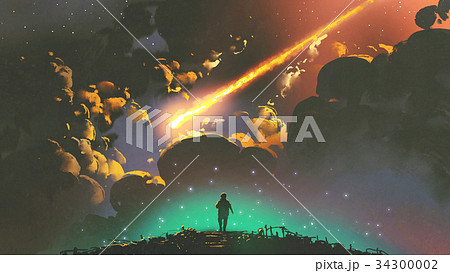 boy looking the meteor in the colorful sky 34300002