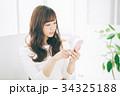 女性 スマホ スマートフォンの写真 34325188