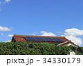 太陽光発電システム_赤瓦とソーラーパネル 34330179