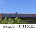 太陽光発電システム_赤瓦とソーラーパネル 34330181