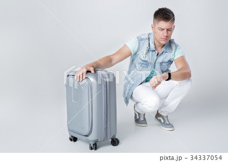 young man in blue shirt with suitcase の写真素材 [34337054] - PIXTA