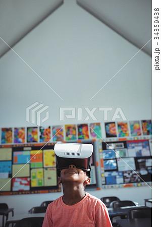 Boy with virtual reality simulator in school 34359438