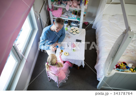 Father and girl toasting their tea cups while playing with toy kitchen setの写真素材 [34378764] - PIXTA