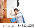 man throwing clothes in air 34381825