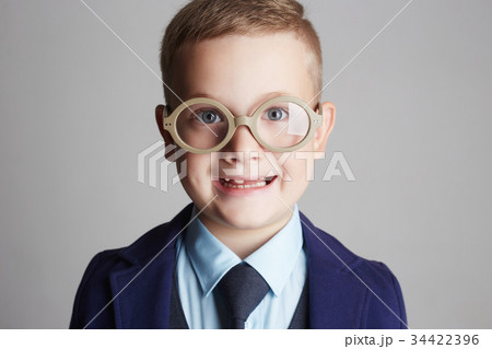 funny smiling child in glasses and siut 34422396