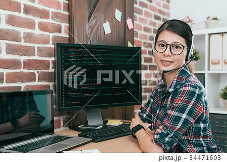 smiling confident call center female employee 34471603