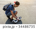 Outgoing young man walking with gyroscooter 34486735