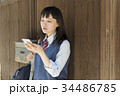 女子高生 スマートフォン 見る 34486785