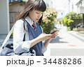 女子高生 スマートフォン 操作 34488286