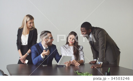 Group of business people using tablet computer 34503246