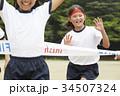 運動会で走る小学生 34507324