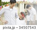 運動会に参加する親子 34507543