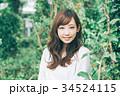 女性 ヘアスタイル 笑顔の写真 34524115