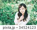 女性 ヘアスタイル 笑顔の写真 34524123