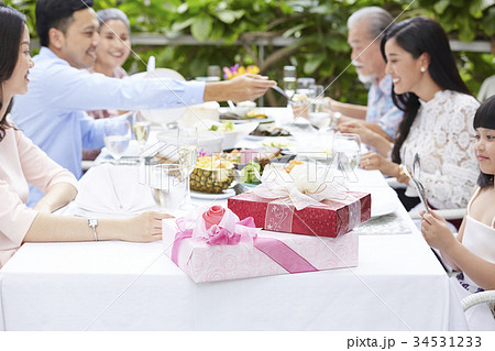 two colorful presents are on the table of a family party in a luxurious restaurant 34531233