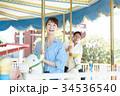男女 カップル 遊園地 34536540