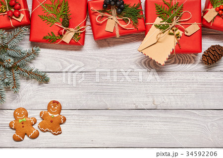 Christmas presents on wooden backgroundの写真素材 [34592206] - PIXTA