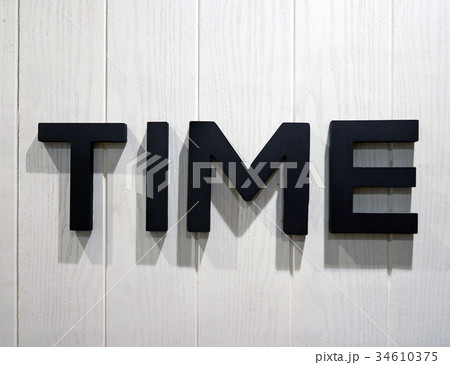 Black Time letters on white wood backgroundの写真素材 [34610375] - PIXTA
