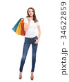 Young, attractive and happy shopping girl with bright shopping b 34622859