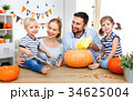 family mother father and children cut pumpkin 34625004