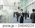 スマートフォン ビジネスマン ビジネスの写真 34640229
