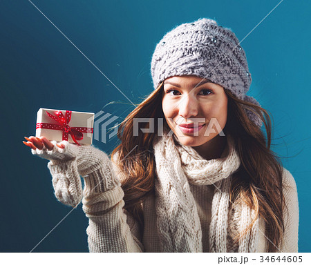 Young woman holding a Christmas giftの写真素材 [34644605] - PIXTA