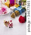 クリスマスイメージ(サンタとトナカイ) 34677865
