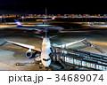 羽田空港 夜 旅客機の写真 34689074