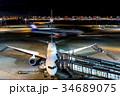 羽田空港 夜 旅客機の写真 34689075