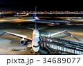 羽田空港 夜 旅客機の写真 34689077