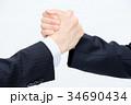 ビジネス 男女 握手の写真 34690434