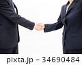 ビジネス 男女 握手の写真 34690484